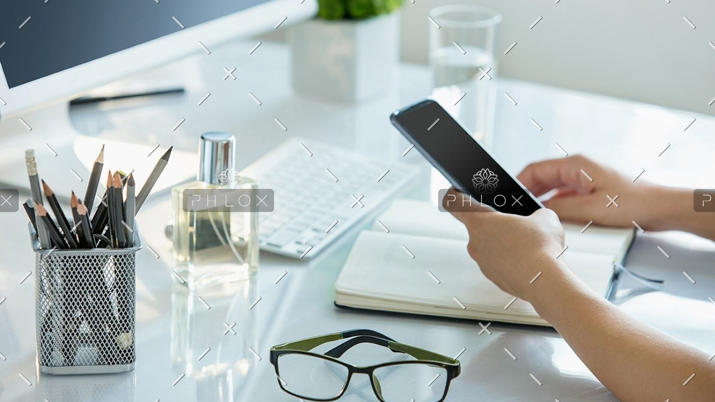 close-up-of-female-hands-using-smart-phone-while-PWQR3QP-1